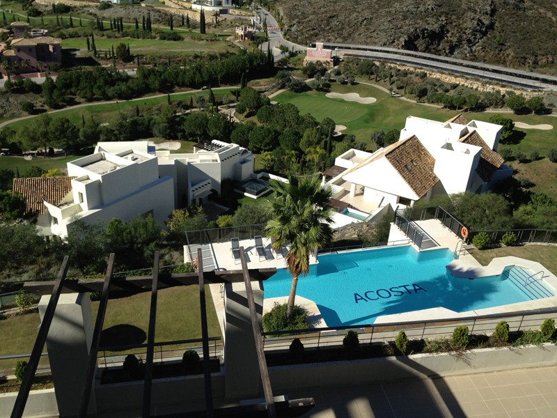 Apartment in Spain, Benahavís: View of one of the pools from the terrace.