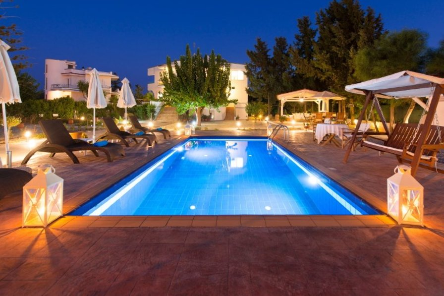 Villa in Greece, Rhodes Town: pool and villa at night