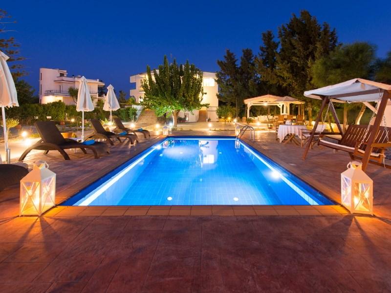 Villa in Greece, Rhodes Town: pool and villa at night