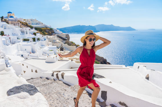 Woman in red dress in Santorini