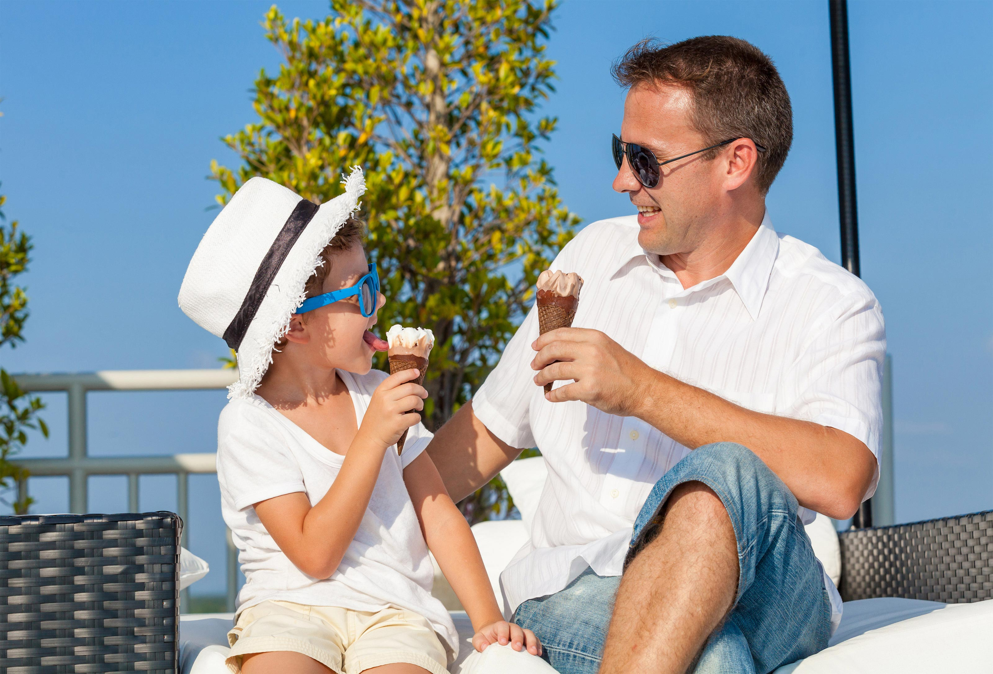 Dad and son licking ice cream